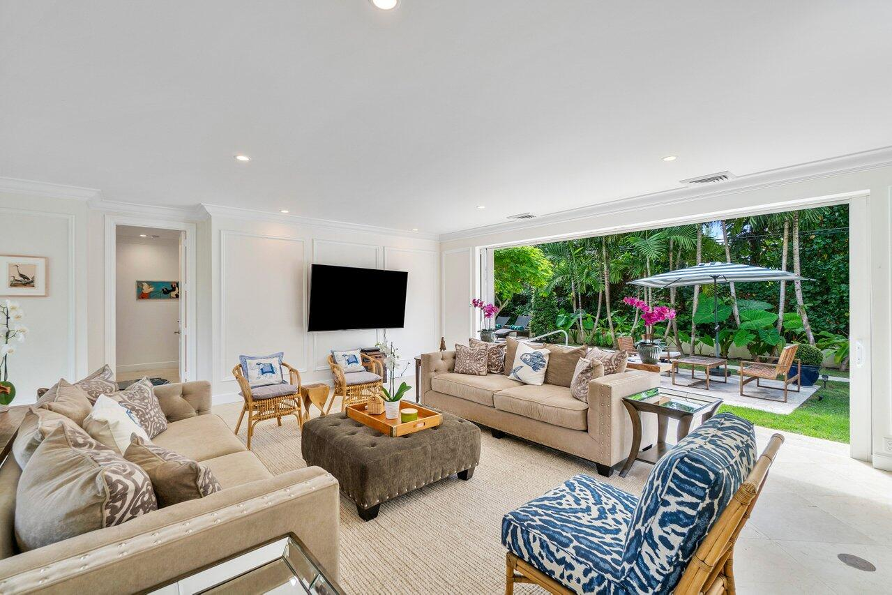 This bright, Bermuda-style 4 bed and 4 bath home captures the charm of Palm Beach with golf course views and a pool surrounded by all new lush landscaping and an expanded patio/garden area. Every room has a walk out that opens up to the wonderful, tropical gardens that this home offers. It also includes a 2 car garage, a formal dining room with butler's pantry, stone flooring, high ceilings, and an updated chef's kitchen with Wolf appliances.