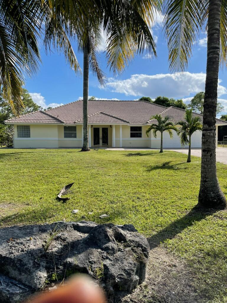 Home for sale in incorporated The Acreage Florida