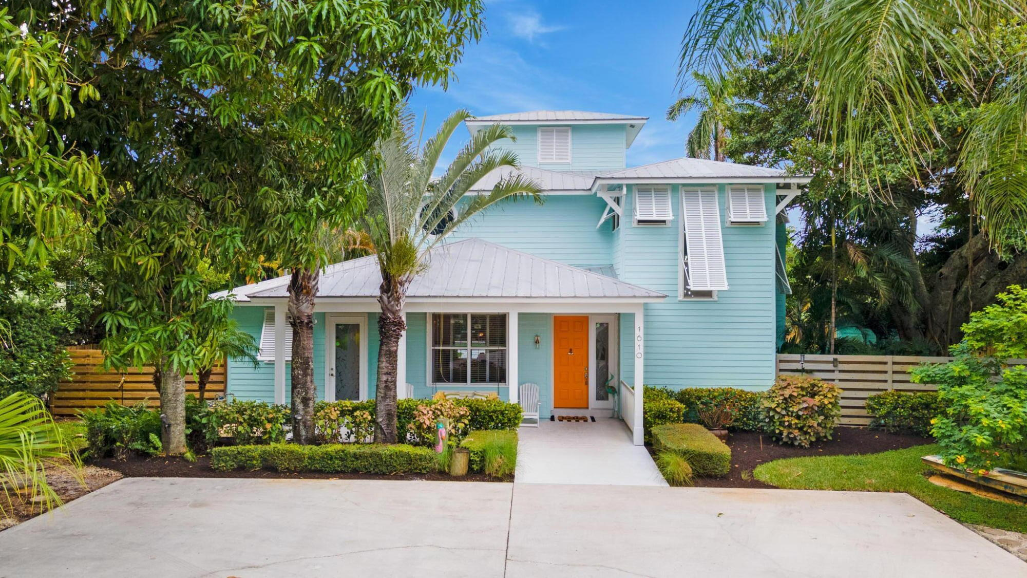 Bright and alluring Key West-Coastal style home on a highly desirable street. This beautiful home on an oversized lot has Intracoastal and golf course views, an open floor plan and has undergone extensive renovations. The stunning gourmet, upgraded kitchen boasts two 9 foot matching islands with extra thick, gorgeous quartz countertops, Kitchen Aid chef-grade appliance suite, dual fuel stove, appliance garage, built-in microwave, wine fridge, two pantries, breakfast area and formal dining room.  Must-see laundry room includes custom cabinetry, quartz countertops, LG washer and gas dryer, farm sink and ample storage space.  The expansive back yard paradise of more than half an acre is ideal for entertaining and features a substantial saltwater pool with fountains, covered and extended patio, fire pit, basketball court, bamboo fenced-in yard and large storage shed. The extensive driveway also allows plenty of parking.  Retreat into the large primary suite featuring three custom closets, including two walk-ins, and a covered balcony overlooking the lushly landscaped backyard and Intracoastal waterway. The fully remodeled  bath has dual sinks, as well as a separate shower and luxurious freestanding tub and Toto toilet. A unique feature of this home is the spiral staircase from the primary bedroom which leads to the sun-filled bonus room with balcony - ideally suited for a home office, yoga studio or gym. In addition, a first floor mini-primary bedroom boasts two closets plus private access to patio, pool and gardens.  Freshly painted inside and out, other updates include whole house water filtration system, new A/C for the upstairs, beautiful sun-filled staircase, new baseboard and trim, 4 zone sprinkler system including rust removal system, upgraded lighting and closet systems, tankless water heater, pickled oak floors, Italian porcelain wood-looking floors with matching decorative barn door that opens to the bathroom and bedroom on the first floor and more.  Your drea