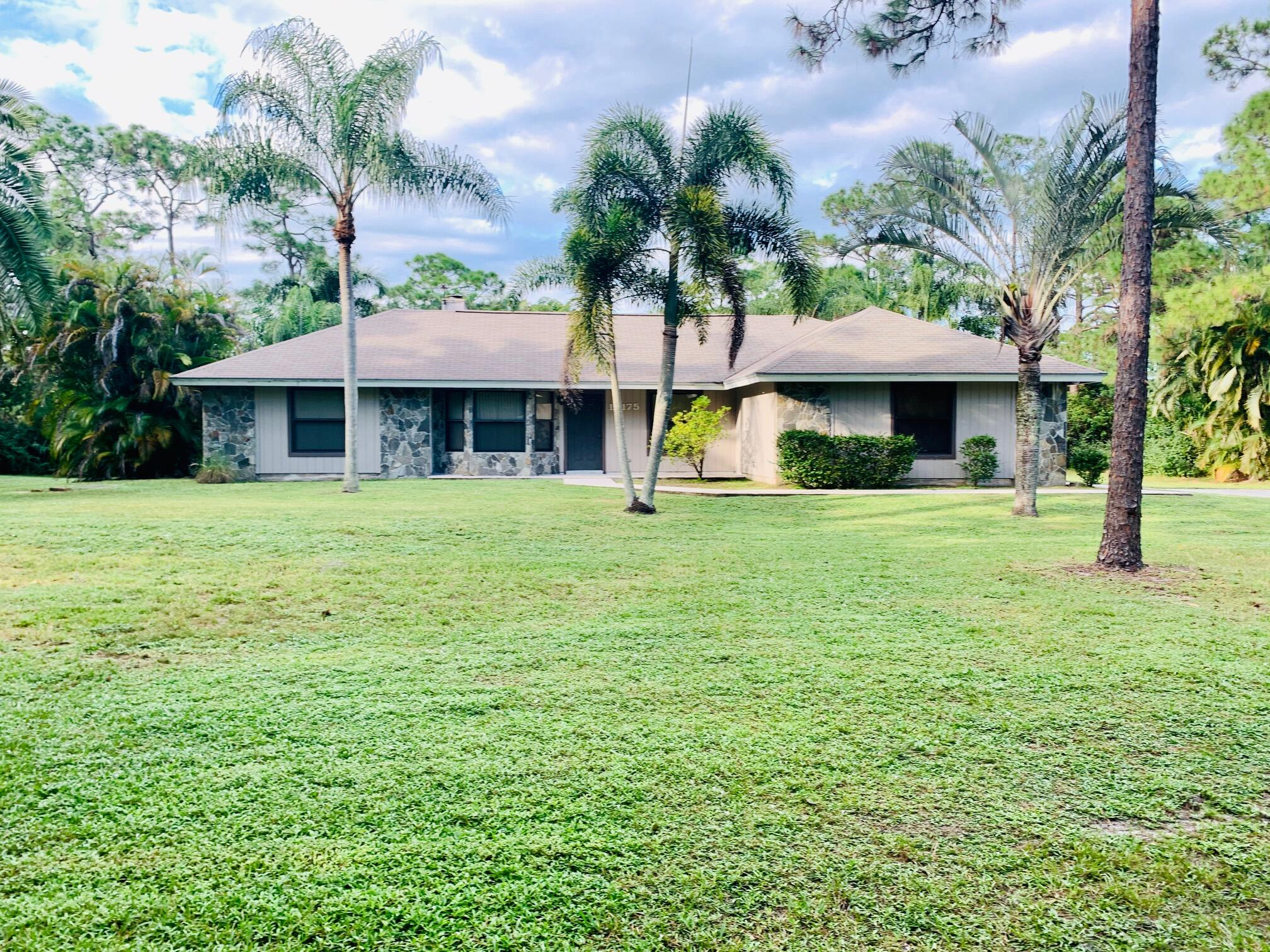 Lowest priced pool home in Jupiter Farms. 3/2/2 on 1.15 acres. Open floor plan. Charming vaulted ceilings with wood beams and real wood burning fireplace. Impact windows and original owner. Screened in patio and large pool on private lot.