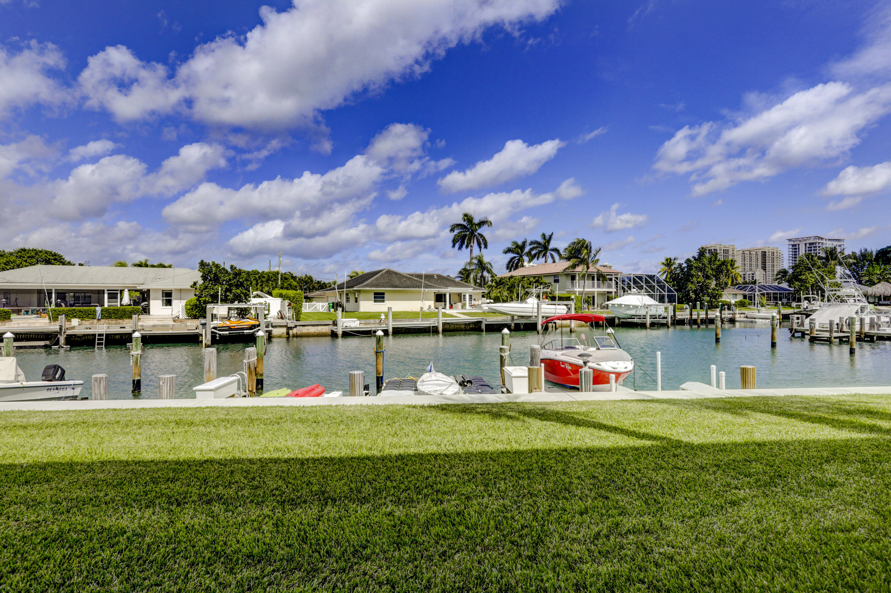 Rarely available 1st floor waterfront home with large screened patio available for immediate occupancy. As you enter the home you will notice the white & bright updated kitchen and white marble look modern tile flooring throughout. 2021 Water heater and 2018 Air Conditioner. A large great room overlooks your water/marina view and oversized screened patio. Two large bedrooms complete this perfect winter or year round home in one of the most desirable locations, Singer Island. The master bathroom features a large stall shower and walk in closet. The guest bathroom features a tub/shower. The community boasts deeded beach access, a large community clubhouse with the largest pool on Singer Island. Boat slips available for purchase or rent. Make this your home today!