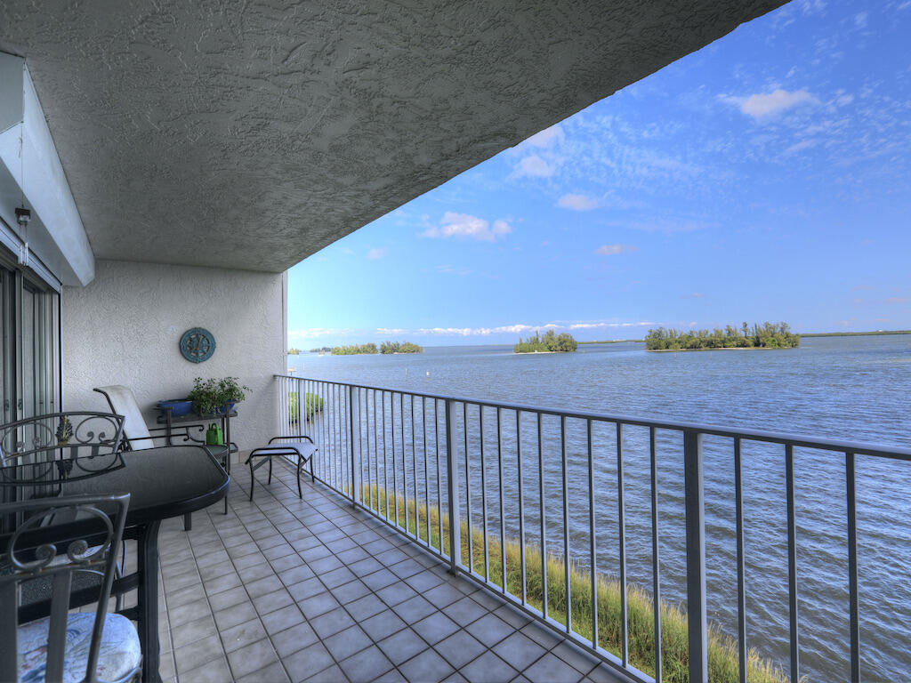 Direct 3/2 Riverfront Condo w/ Expansive Panoramic Unobstructed Views, Enjoy Dolphins, Manatees, fish & much morefrom your 27 feet of covered balcony. Upgraded Kitchen, Fresh Paint & Meticulously maintained. River Run Community Features Clubhouse, heated pool, tennis & gym. Close to beach, shopping & dining. 1 Car Garage included with door opener. Sizes are approx/subj to error.