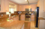 With Stainless steel appliances and granite countertops