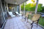 Relax on your spacious screened in balcony