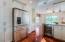 High end granite on countertops and backsplashes, under cabinet lighting, Kitchenaid appliances.
