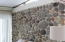 Very unique wall in living room- These stones were all recovered from wrecks in the keys!
