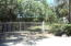 Large property is fenced & gated