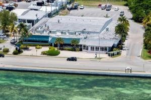Oceanfront commercial complex with two operating oceanfront restaurants. Attention investors and 1031 Exchange Key West Buyers! Two Atlantic Oceanfront restaurants on 1.3 acres of land right next to the newly renovated Key West International Airport and located adjacent and next to two major resorts on the Oceanside of Key West, an Oceanfront Best Western and Hyatt Resort with close to 300 units. Tenant on property will deliver a cap rate of over 7.5%.