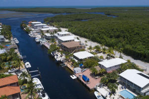 Best value on Ocean Isle Estates with 70' of concrete dock, deep water and davits
