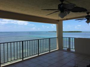 This corner condo at The Palms sits direct oceanfront!