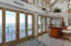 French doors open to expansive ocean views