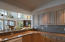 Granite kitchen with island and custom hardwood cabinets