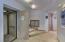 Custom lighting for art in foyer
