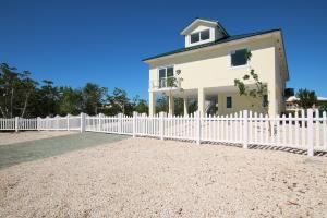 Paver Driveway and Fencing with Rolling Gate Recently Installed
