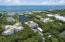 Oceanfront complex with protected dockage and sandy beach