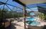 Screened enclosure around pool area