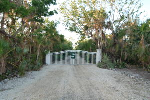 Build Your Dream Home on this Beautiful Florida Bay Open Water Waterfront 1 Acre Vacant Lot located on Prestigious Morton Street on Grassy Key. This Waterfront Vacant Lot is very Privately located within a Pristine Native Tropical Hammock. This Open Water Vacant Lot has Spectacular Florida Bay Water Vistas and Fabulous Sunsets, a Natural Gateway to World Class Fishing and Diving. A grandfathered Tidal Pool on this Waterfront Lot is located adjacent to the existing Concrete-Rip Rap Sea Wall.