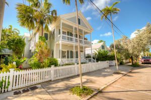 A Key West Grande Dame in the heart of Old Town w/5BR/4.2BA, incl. a 1BR/1BA guest cottage, a 1BR guest cottage & an optional 6th bedroom in what is now a den. Relax by the large pool, lounge on any one of 5 porches or balconies, grill a delightful meal in the covered & vented outdoor cooking area. Large great room & flowing design make entertaining a delight, especially with the brand new powder room built just off the side with access as a pool bath as well. Master BR has soaring ceilings & a huge pair of his/her closets. Access to Baker's Ln via locked gate, Dynasty & SubZero appliances, built-in wine fridge for 147 bottles, 25KW generator, gated off street parking, X-flood zone, even a well to water the extensive grounds! This is one of the rare properties that has it all!