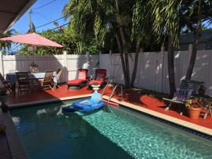 Nice size swimming pool and spacious home with outdoor bonus room.