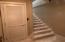 Elevator door and interior stairway to main level
