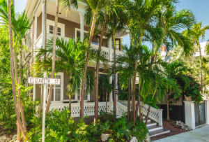 This historically significant classical revival home built circa 1890 by sea Captain Benjamin Saunders is located in the heart of Old Town Key West.  It is two blocks from Duval Street, one block from the Historic Key West Seaport and the Eaton Street Arts District and in easy walking or biking distance to all that Key West has to offer.  There is 2,450  sf of living area with 4 bedrooms and 2 bathrooms & a large outdoor double shower; high ceilings & Dade County pine throughout.  Upon entering, you encounter the elegant dining room adjacent to the comfortable & stylish living room. The kitchen features stainless-steel countertops, stainless steel appliances & a spacious eat-in dining area.  The first floor has multiple porches and verandas wonderfully capturing the Key West lifestyle.