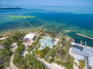 Beautiful home on exclusive Morton Street, Grassy Key.Located directly on the Bay of Florida on a 2/3 acre lot with 155 feet of  boulder shoreline. Deep water dock with pilings to tie up large boats. All concrete construction with tile roof. 2624 S/F on main level plus 1400 s/f dbl. garage and storage on 1st level. 1st level foyer with elevator. 8 ft. doors thru-out, high ceilings, Travertine marble floors inside & out. PRIVACY, PRIVACY, PRIVACY!