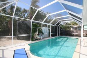 Pool home for sale in Port Largo.  Ground level home in the center of Key Largo, walking distance to shopping, restaurants, public park, etc.  Seller is meticulous when it comes to maintenance.  Optional membership in the homeowners association provides access to the waterfront homeowners park with boat ramp and beach area.