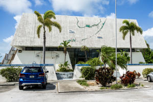 One of a kind Commercial building in Lower Keys sitting on large 40,000 sf. corner lot. 200' of highway frontage x deep on W. Shore Dr.  Special purpose concrete building on two stories. Built well above base flood levels, concrete slab construction, elevator, reinforced concrete floors.  Originally built as a bank in 1980.   & minimal damage from Hurricane Irma. Ample customer and employee parking with easy access on/off highway. Total leasable 9,175 sf. currently leased to US Government -FEMA at $23/sf. full service lease. Many options include office, retail, light industrial or multi unit with affordable housing.