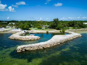 THE ZIM ESTATE (photos and video are pre-Hurricane Irma) is an impressive 7.73 acre oceanfront estate located on Millionaire's Row with a total of 5 homes (8 parcels) on 6.57 acres upland plus 1.16 acres bay-bottom. The Village has confirmed 7 market-rate units. The protected boat basin is approx. 200' x 70' with deep-water draft. The 440' of waterfront affords outstanding ocean views, and spacious, open outdoor island living.