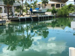 Wide flow-through canal at 927 Gulf Drive on Summerland Key, FL - ocean side.