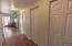 4 storage closets on the right side and a large bedroom at the end of the hallway