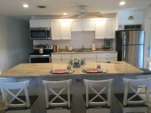 The beautiful island looking towards the kitchen and the stainless steel appliances
