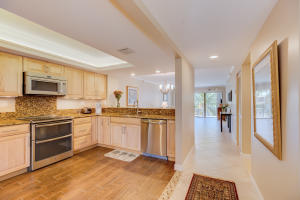 Open, updated kitchen with porcelain flooring, granite tops, maple cabinetry and lighted, recessed ceiling!