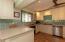 Quartz counters, glass backsplash, ss appliances