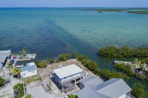 Last house on the canal and first one on the Gulf; This is a rare Bayfront Waterfront home!