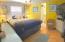 Wood laminate flooring, crown moldings, and ensuite bathroom!
