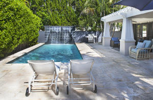 Swimming Pool with Water Fall and lush tropical gardens