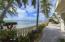 Paver pathways along expansive shoreline.