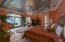 Expansive master suite with picturesque water view.