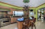 Well appointed kitchen featuring gas stainless steel appliances.
