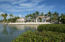 Grand tropical estate with breathtaking architecture and water views. The ultimate boating location.