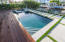 Heated pool and spa with deck jets and custom lighting