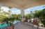 Covered deck overlooking pool/grounds