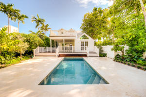 Exquisitely restored & extensively renovated, a captivating 2 1/2 story Conch home in the heart of Old Town. 4 BD's & 3.5 BA's, spread over 2,500 sq. ft. of living space on a 6,400 sq. ft. lot, in the prized X Flood Zone, just a short walk to Duval Street & the Key West Historic Seaport. Current owners have refined every detail of this fabulous property. An open floor plan greets you as you open the antique front door, plentiful windows allowing for an abundance of natural light. All new hard wood flooring throughout and a hurricane rated Nanowall door opens to an oversize ipe deck for entertaining, eating or simply enjoying the fabulous Key West climate overlooks the pool. Kitchen features all new cabinetry, an over size island with wine cooler, Viking appliances and beautiful....