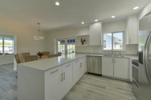 Wood tile floors throughout with recessed lighting