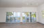 Large sliding glass doors open up to the screened in patio