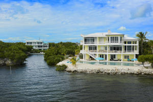 Have It All; Own approximately 6 acres, 4 Custom Houses, 9 Slip Marina, 2 Saltwater Swimming Pools in the Florida Keys