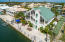 Beautiful 5 bedroom 3.5 bath home with an elevator and 100 ft. of dockage in Venetian Shores