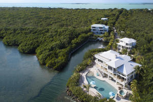 Have It All; Own approximately 6 acres, 4 Custom Houses, 9 Slip Marina, 2 Saltwater Swimming Pools in the Florida Keys Primary Image