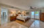 Very large room with sliding glass doors to the oceanfront porch